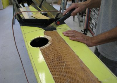 Refinishing rowing shells in our workshop - Saratoga Small Craft